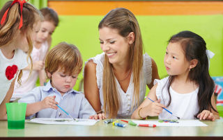 Children are creative painting in kindergarten with a happy nurs
