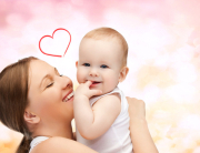 mother-hugging-cute-baby-with -heart