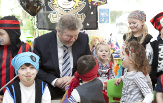 Minister with children