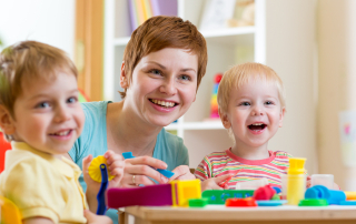 woman teaches children handcraft at kindergarten or playschool or home