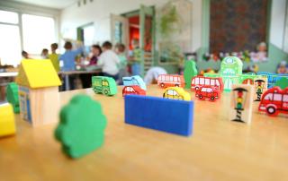 different varicoloured toys in kindergarten close up