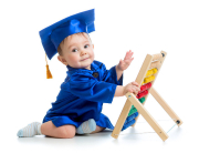 academic baby boy playing with abacus toy