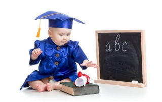 28249470 - baby in academician clothes  with book at  blackboard
