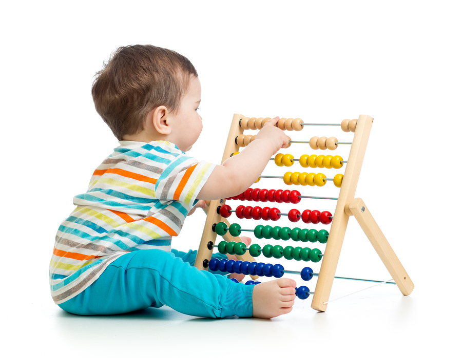 baby child kid playing with abacus, isolated on white background
