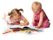Children drawing with pencils lying isolated on white