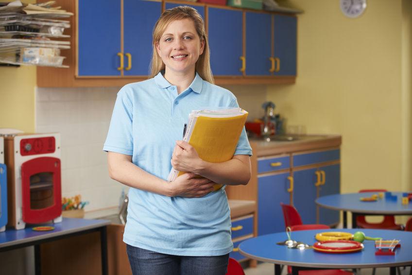 49365219 - childcare worker standing in nursery