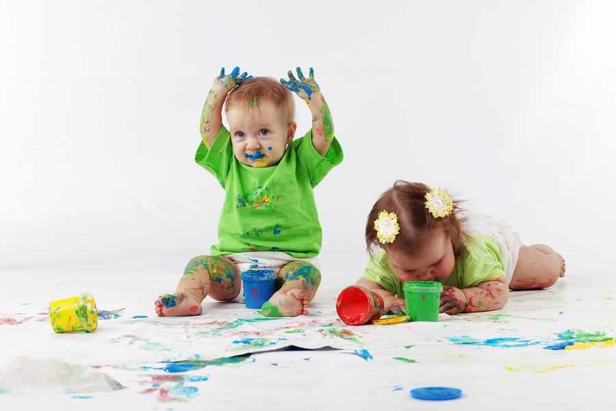 Two babies painting