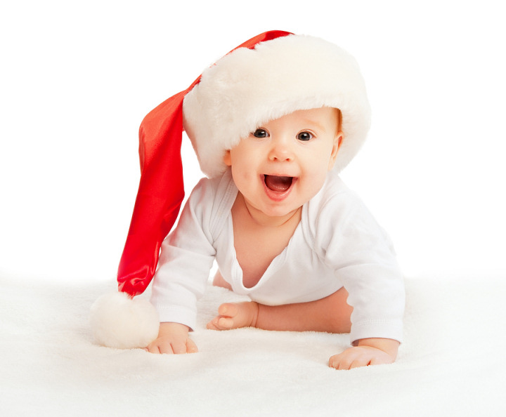 Beautiful baby in a Christmas hat isolated on white background