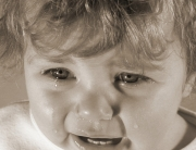 baby crying in sepia tint